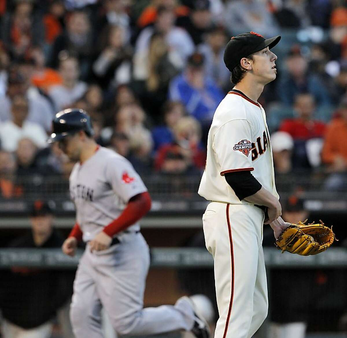Tim Lincecum turns away after a balk that allowed Daniel Nava to trot home.