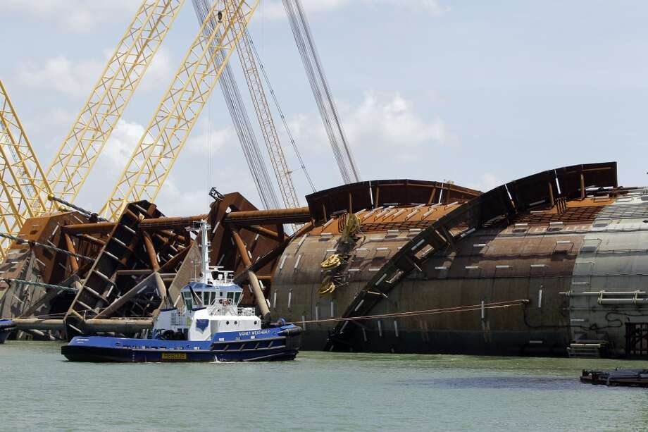 A tugboat is shown beside the Anadarko Petroleum Corporation's Lucius truss spar at Kiewit Offshore Services, 2440 Kiewit Road, Thursday, July 11, 2013, in Ingleside. It is the largest spar built to date by Anadarko. The diameter of the spar is 110 feet and the length is 605 feet. ( Melissa Phillip / Houston Chronicle ) Photo: Melissa Phillip, Houston Chronicle