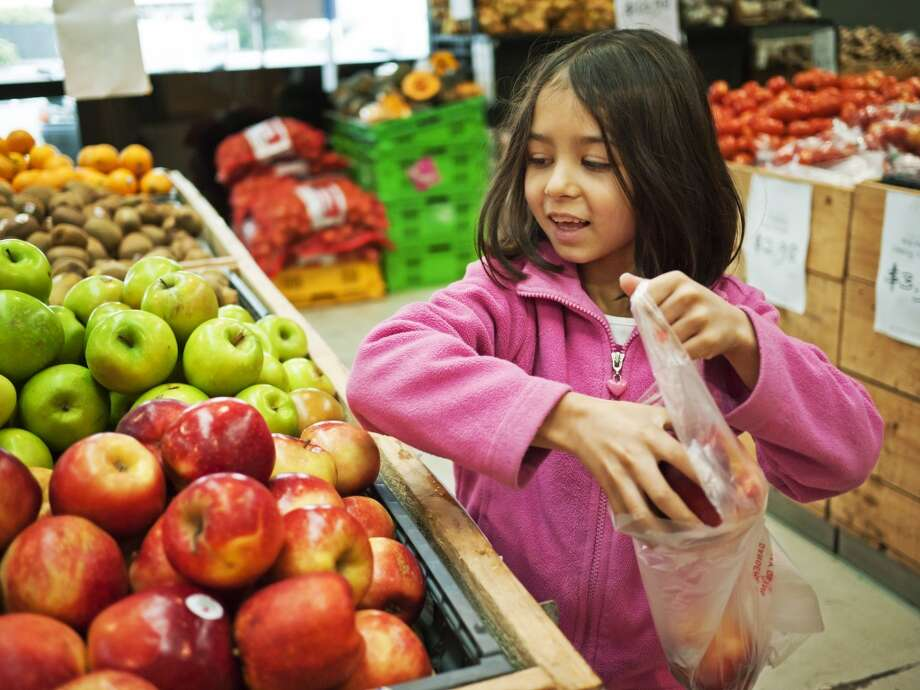 Focus on nutrition. A few days before school starts, plan a trip to the grocery store with your kids so they can pick out healthy snacks and lunch options they'll actually eat. Photo: Donald Iain Smith, Getty Images/Flickr RF