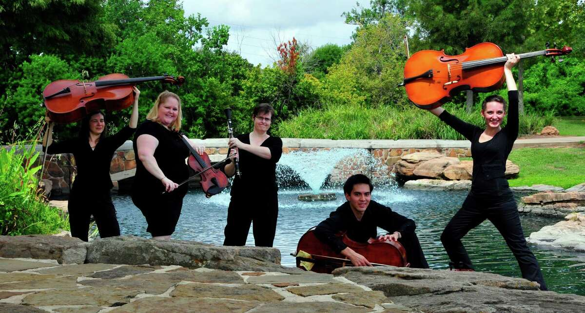 Members of the Fort Bend Symphony Orchestra celebrate the upcoming season at Oyster Creek Park.