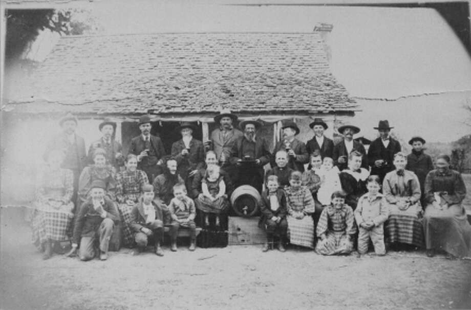 Evers Road was probably named after Christian Evers, who expanded the land holdings of his German immigrant father Claus Hartwig Evers from 2,011 acres to 1,300 acres and later donating 2 acres for the first area school. In this 1899 file photo, Claus and Johanna Evers are shown with their descendents in front of their homestead. Photo: File Photo