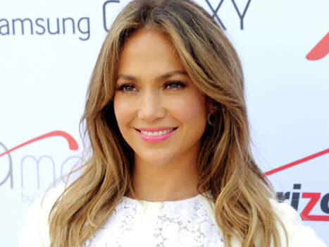 "Singer and actress Jennifer Lopez attends the ""Viva Movil by Jennifer Lopez"" flagship store grand opening in Brooklyn on Friday, July 26, 2013 in New York. Photo: Evan Agostini, Evan Agostini/Invision/AP / Invision"