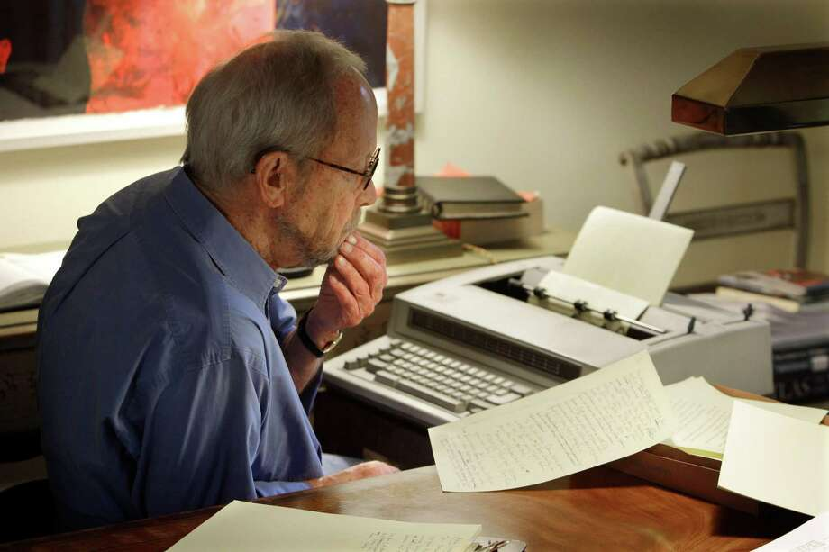 FILE - In this Sept. 28, 2010 file photo, author Elmore Leonard works on a manuscript at his home in Bloomfield Township, Mich. Leonard, the best-selling chronicler of schemers, clever conmen and casual killers, has died, announced Tuesday, Aug. 20, 2013. (AP Photo/Carlos Osorio) ORG XMIT: NYEL101 Photo: Carlos Osorio / AP