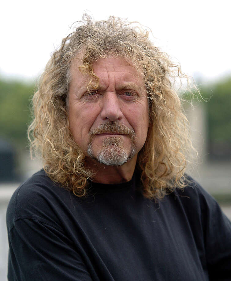 Robert Plant poses as he signs his 10 foot Gibson Les Paul Guitar as part of the Gibson Guitartown London charity campaign at More London on September 05, 2007 in London, England. Photo: Stuart Wilson, Getty Images / 2007 Getty Images