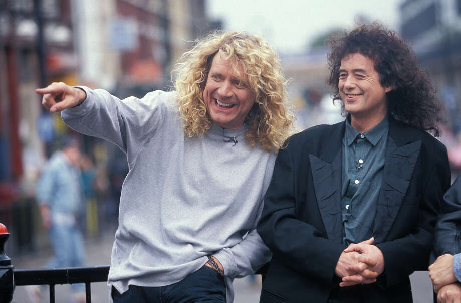 UNITED KINGDOM - JANUARY 01:  Photo of Jimmy PAGE and PLANT & PAGE and Robert PLANT and PAGE & PLANT; Page & Plant - Robert Plant & Jimmy Page of Led Zeppelin posed outside Camden Tube Photo: Mick Hutson, Redferns / Redferns