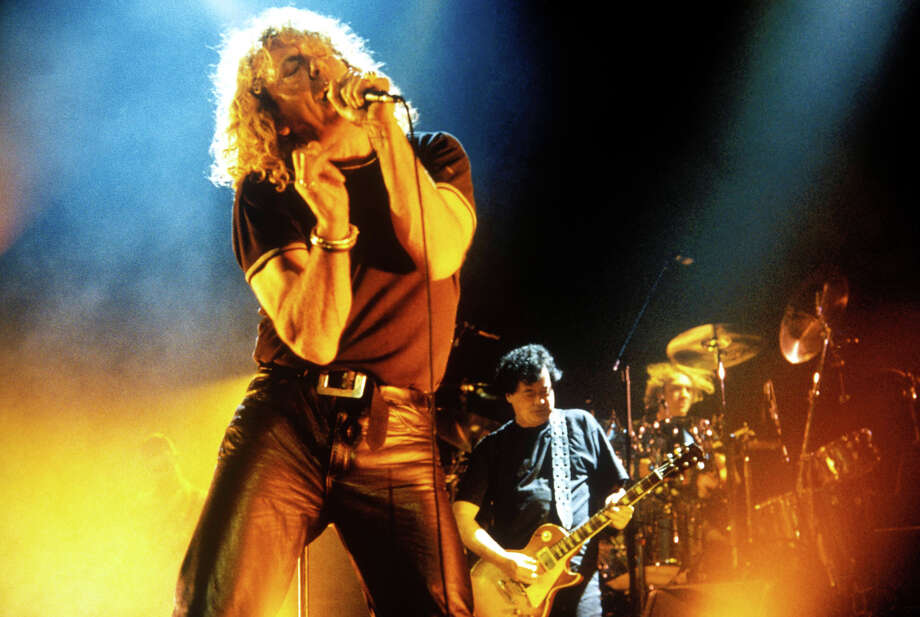 Robert Plant & Jimmy Page of Led Zeppelin, with drummer Michael Lee behind, performing live onstage. Photo: Tony Buckingham, Redferns / Redferns