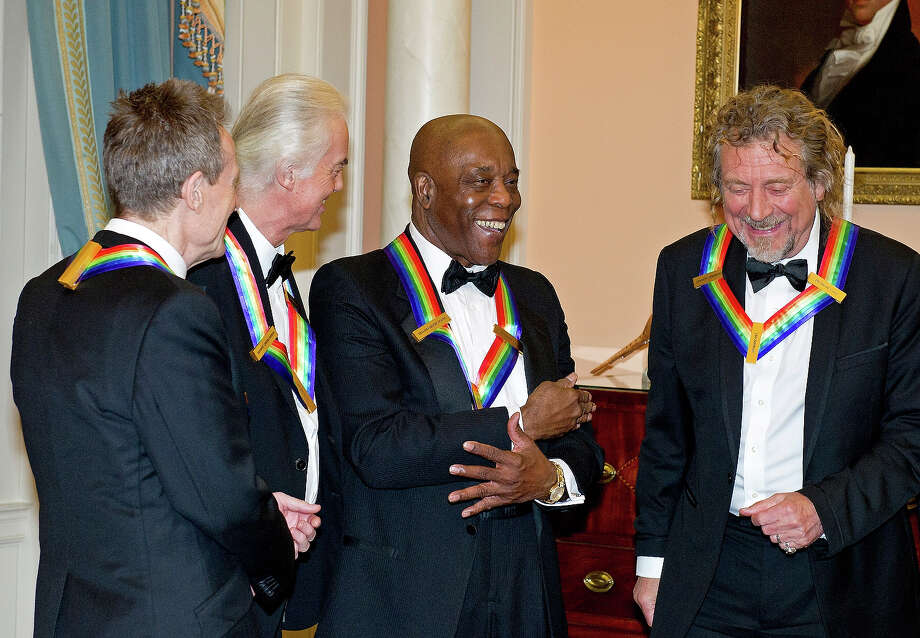 John Paul Jones, Jimmy Page and Robert Plant of Led Zeppelin speak with Buddy Guy (2nd R) as they prepare to pose for a photograph following a dinner for Kennedy honorees hosted by U.S. Secretary of State Hillary Rodham Clinton at the U.S. Department of State on December 1, 2012 in Washington, DC. The 2012 honorees are Buddy Guy, actor Dustin Hoffman, late-night host David Letterman, dancer Natalia Makarova, and members of the British rock band Led Zeppelin Robert Plant, Jimmy Page, and John Paul Jones. Photo: Pool, Getty Images / 2012 Getty Images