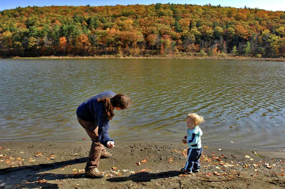 PHILIP KAMRASS/TIMES UNION -- Brian Mangini of Clarksville shows his one year old son Jeremiah how to skip stones following a quick picnic lunch at Lawson Lake County Park in Coeymans, NY Monday October 20, 2008. Photo: PHILIP KAMRASS, ALBANY TIMES UNION