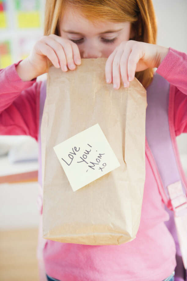6. Try to put surprises in lunches, such as a note or sticker, to give kids something to look forward to. Photo: Jamie Grill, Getty Images / (c) Jamie Grill