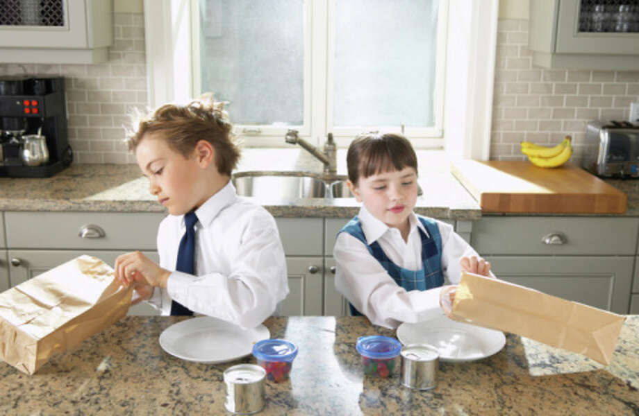 9. Get your kids to help with packing lunches - they'll cut the preparation time and learn about nutrition along the way. Photo: NULL, Getty Images / Radius Images