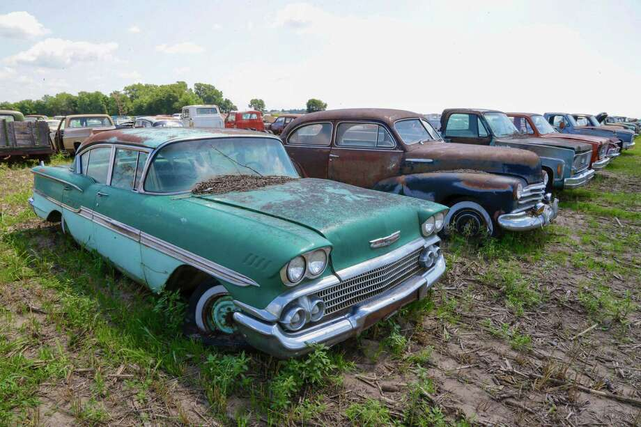 In this Aug. 12, 2013 photo, a 1958 Chevrolet Biscayne is lined up with others at a field near the former Lambrecht Chevrolet car dealership in Pierce, Neb. Next month, bidders from at least a dozen countries and all 50 U.S. states will converge on Pierce, a town of about 1,800 in northeast Nebraska, for a two-day auction that will feature about 500 old cars and trucks, mostly Chevrolets that went unsold during the dealership's five decades in business. About 50 have fewer than 20 miles on the odometer, and some are so rare that no one has established a price. The most valuable could fetch six-figure bids. (AP Photo/Nati Harnik) ORG XMIT: NENH105 Photo: Nati Harnik, AP / AP