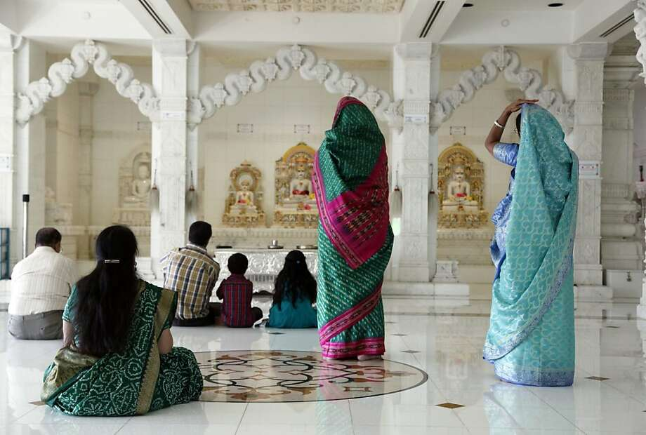 Adherents of Jainism, an ancient Indian religion similar to Buddhism and with strict adherence to nonviolence, pray at the center. Photo: Nick Ut, Associated Press