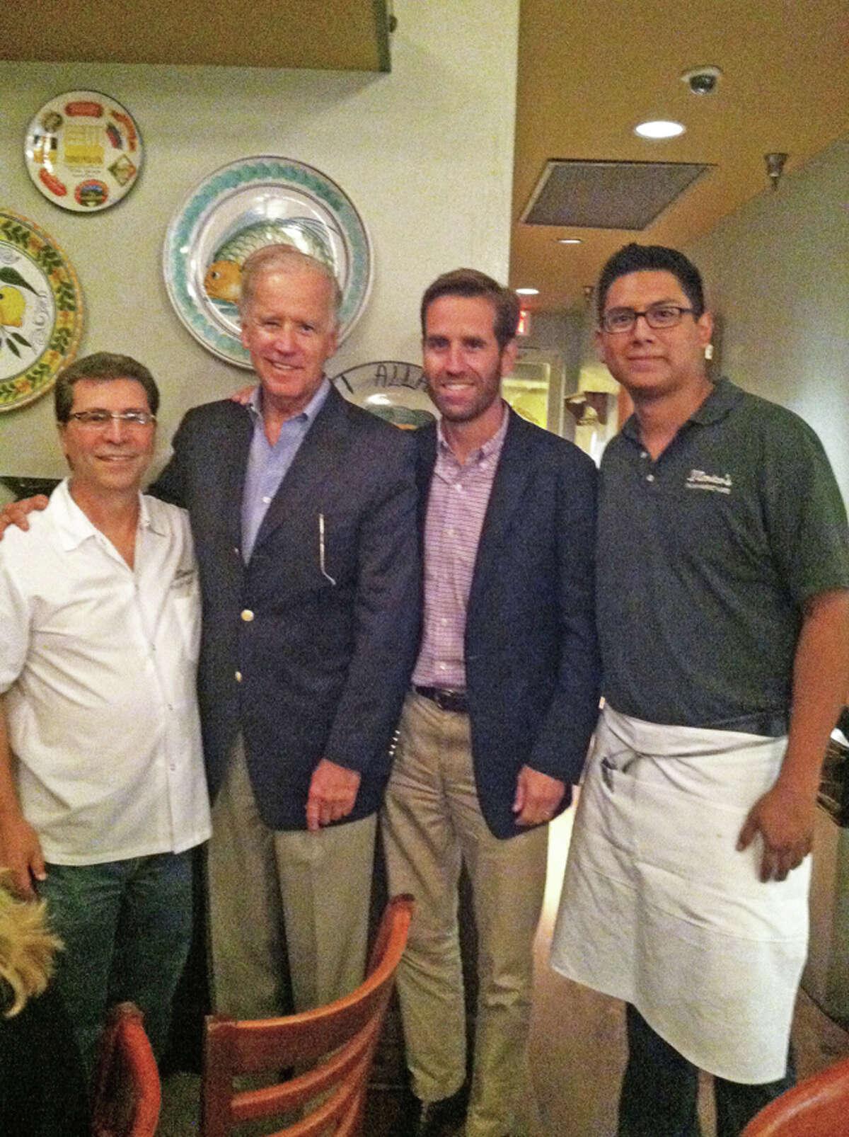 Nash D' Amico, left, poses Monday night with Vice President Joe Biden, Beau Biden and server David Reyes. (Courtesy of Nash D' Amico)