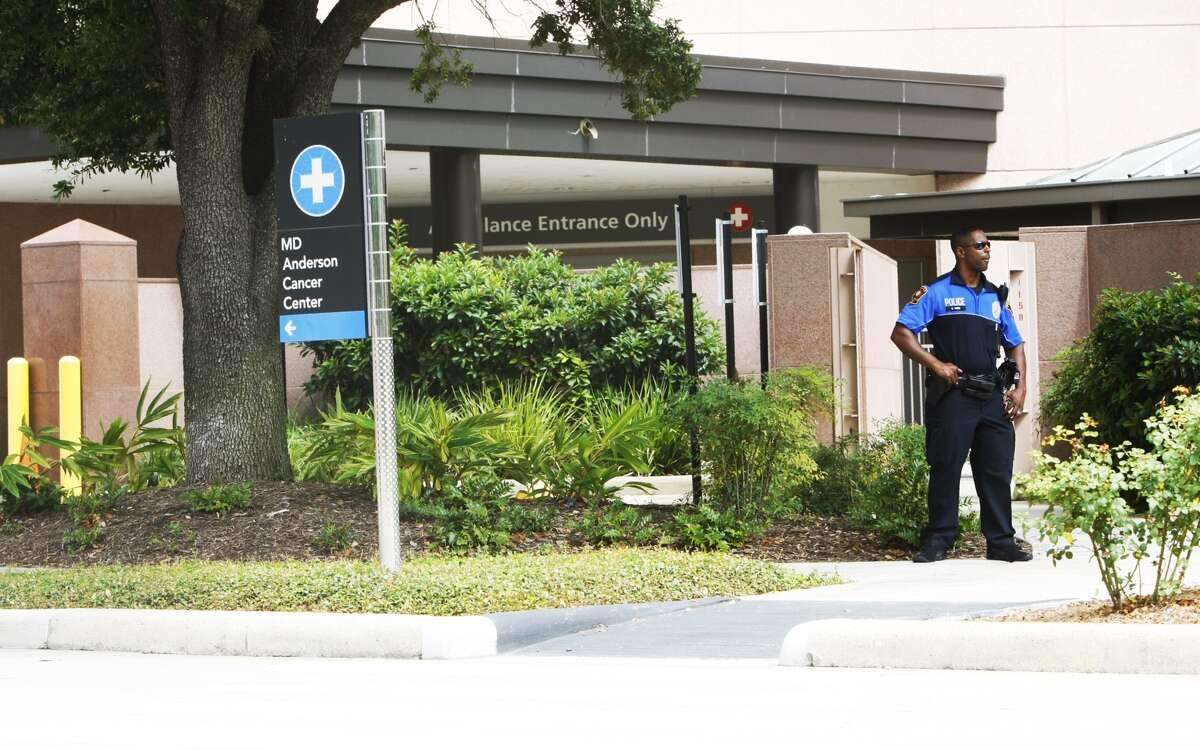 An officer stands in front of the entrance where Vice President Joe Biden reportedly entered Tuesday morning to see his son at the University of Texas M.D. Anderson Cancer Center. Details of Beau Biden's condition have not been disclosed.
