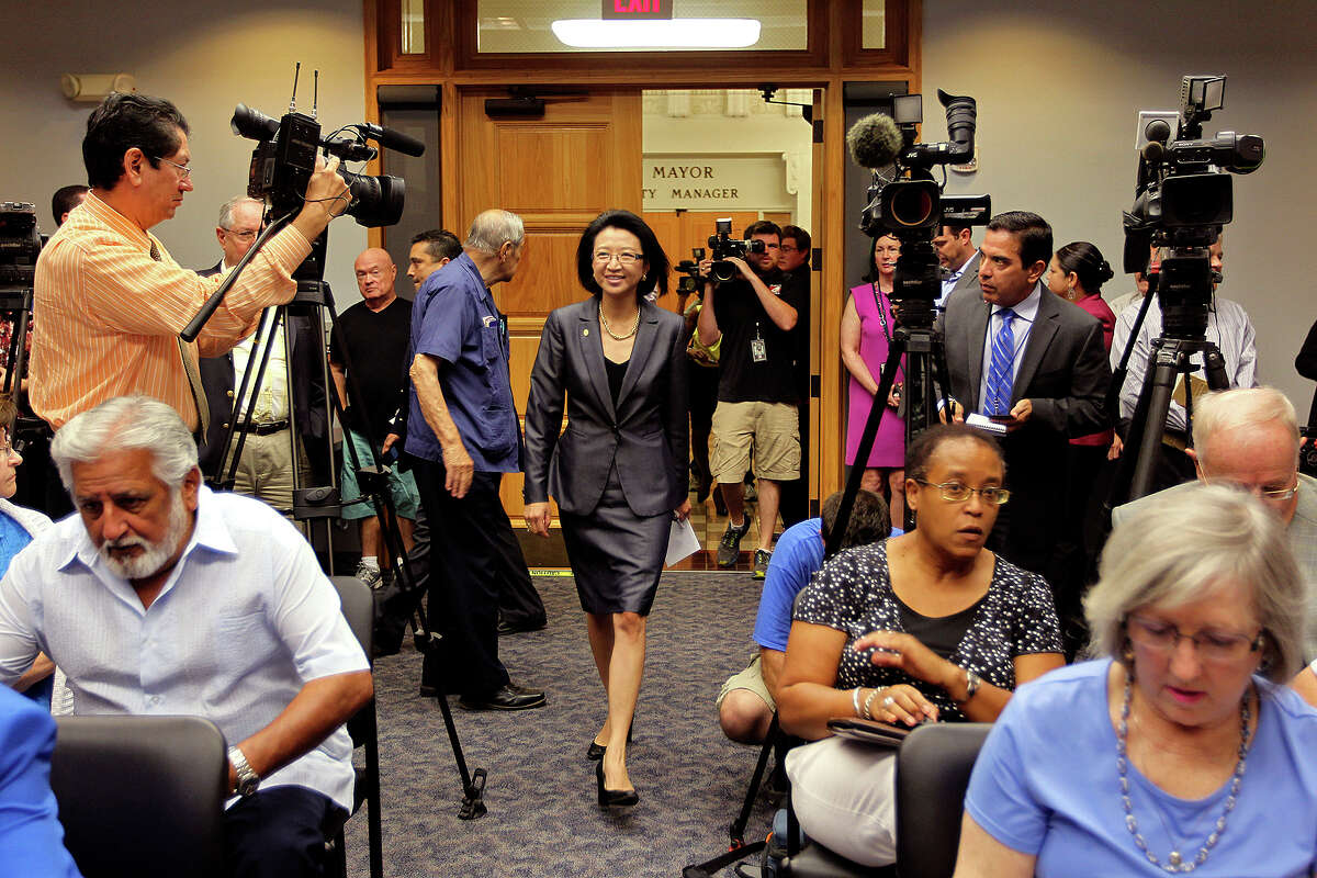 San Antonio City Councilwoman District 9 Elisa Chan enters a briefing room for a press conference at City Hall, Tuesday, Aug. 20, 2013. In a secret recording by former staff member James Stevens on May 21, Chan condemned homosexuality and described it as