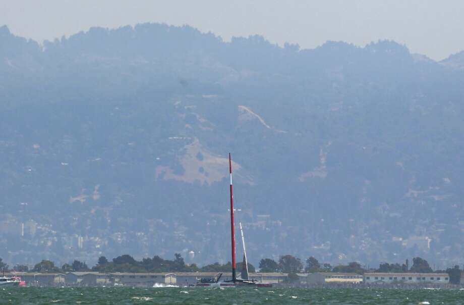 The Luna Rossa boat sits stationary in the water after a portion of its sail broke during Race 3 of the Louis Vuitton Cup Finals on Monday, August 19, 2013 in San Francisco, Calif. Photo: Beck Diefenbach, Special To The Chronicle