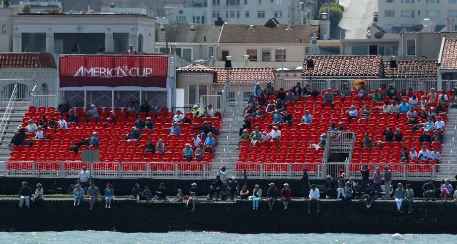 Spectators in grand stands on the Marina Green watch Race 3 of the Louis Vuitton Cup Finals on Monday, August 19, 2013 in San Francisco, Calif. Photo: Beck Diefenbach, Special To The Chronicle