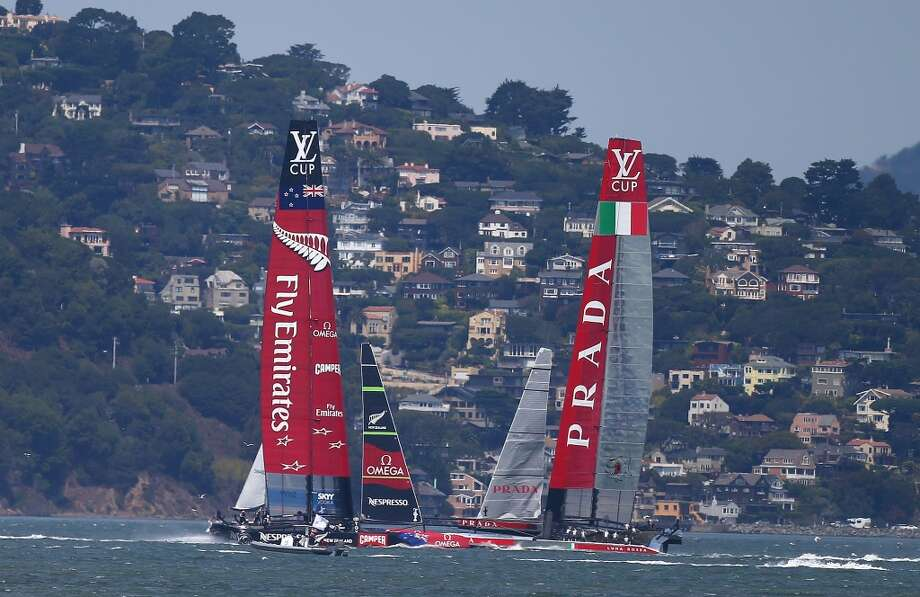 Emirates Team New Zealand skippered by Dean Barker in action against Team Luna Rossa Challenge skippered by Massimiliano Sirena during race three of the Louis Vuitton Cup finals on August 19, 2013 in San Francisco, California. Photo: Jonathan Ferrey, Getty Images