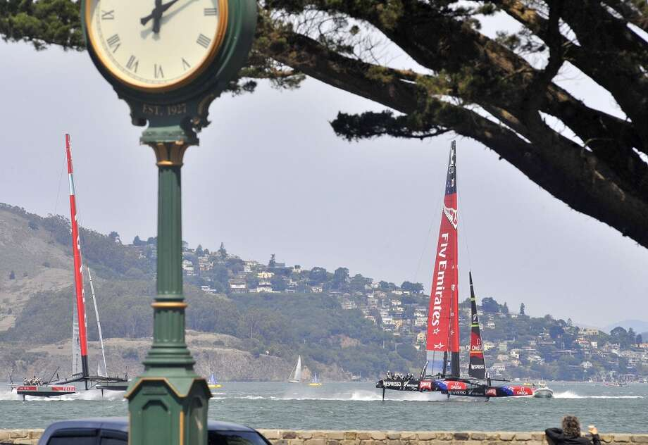 Luna Rossa Challenge (L) and Emirates Team New Zealand (R) sail their AC72s  at the start of the third race of the Louis Vuitton Cup. Photo: JOSH EDELSON, AFP/Getty Images