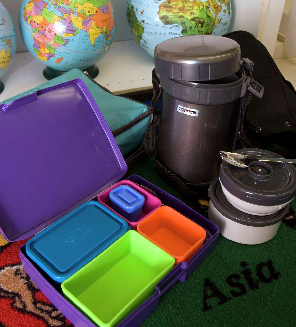 ** FOR USE WITH AP LIFESTYLES ** Bento box-style carriers, shown in this August 2, 2007 photo, are perfect if you like to bring lots of options for lunch. The interior containers can carry hot, cold and liquid foods and many include eating utensils. (AP Photo/Larry Crowe)