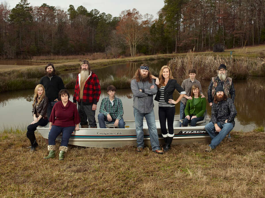 """The Robertson clan has found fame starring on A&E's show """"Duck Dynasty,"""" but they weren't always the heavily-bearded group we know today. Keep clicking to see photos from their family album through the years. Photo: Zach Dilgard, A&E"""
