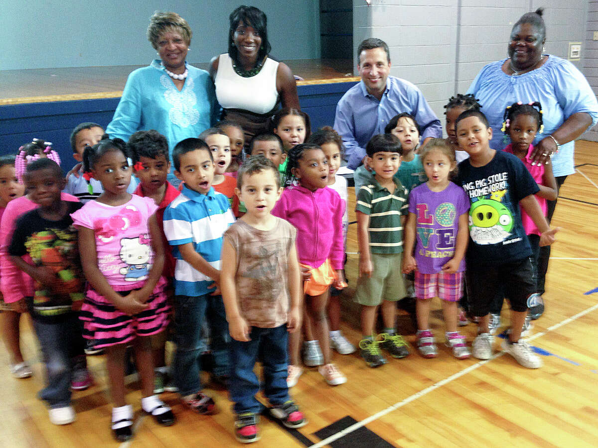 State Senator Bob Duff (D-Norwalk) joined the staff and students of NorwalkâÄôs Head Start program at Nathaniel Ely School on Tuesday to ask the public for donations of backpacks and other school supplies for needy children starting kindergarten this fall.From left to right are Janice Joyner, director of child development, NEON; Chiquita Stephenson, acting CEO, NEON; state Sen. Bob Duff; and Brenda Myrie, family engagement coordinator, NEON.