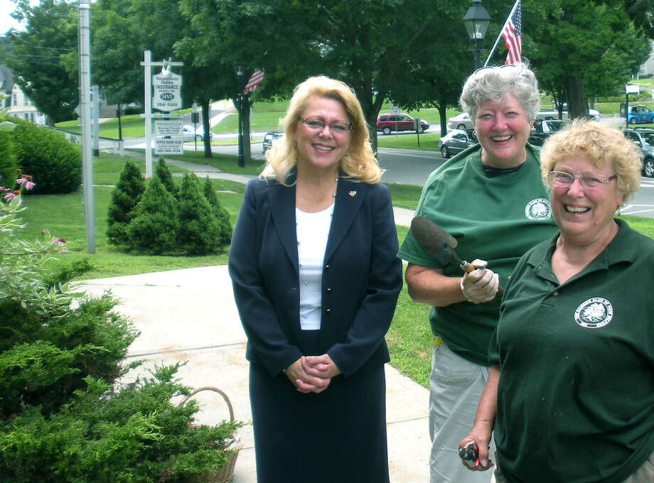 """Mayor Pat Murphy and Ginny Driscoll, center, and Jan Parsons of the Garden Club of New Milford take a moment for a photo in front of the """"Mayor's Garden"""" outside town hall. July 2013                                 Courtesy of the Garden Club of New Milford Photo: Contributed Photo"""