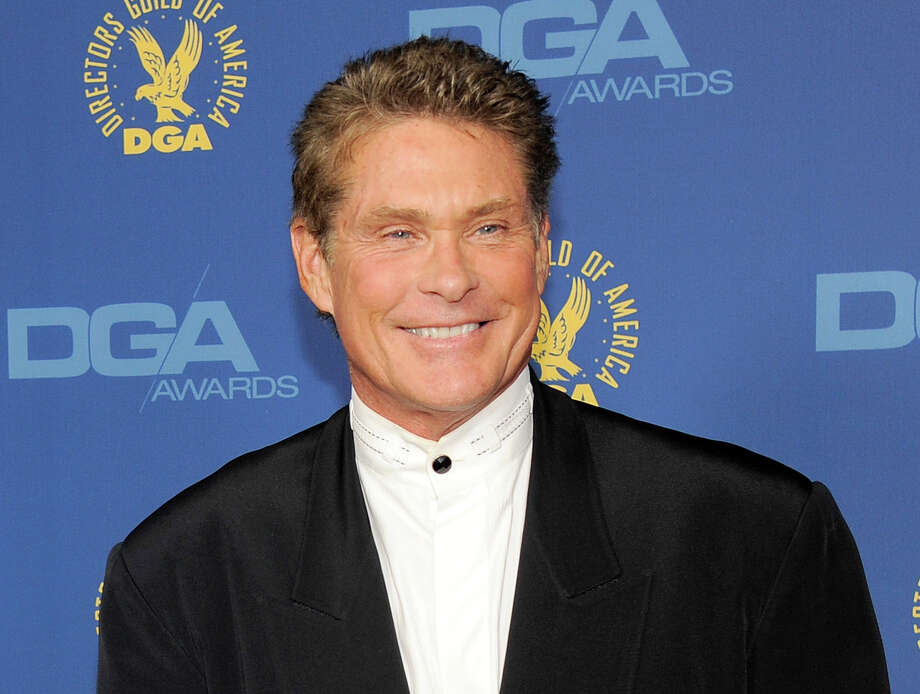 FILE - In this Feb. 2, 2013 file photo, actor David Hasselhoff arrives at the 65th Annual Directors Guild of America Awards in Los Angeles. A convenience store clerk has been critically injured trying to stop the theft of two signs featuring images of actor David Hasselhoff. Authorities say a 36-year-old clerk at a Cumberland Farms in Shelton saw a man put the signs into an SUV early Tuesday, Aug. 20. Police say the worker was struck and dragged by the SUV and landed on his head. Police say the clerk is hospitalized in critical condition, and authorities are looking for the suspects. (Photo by Chris Pizzello/Invision/AP, File) ORG XMIT: NYET856 Photo: Chris Pizzello / Invision