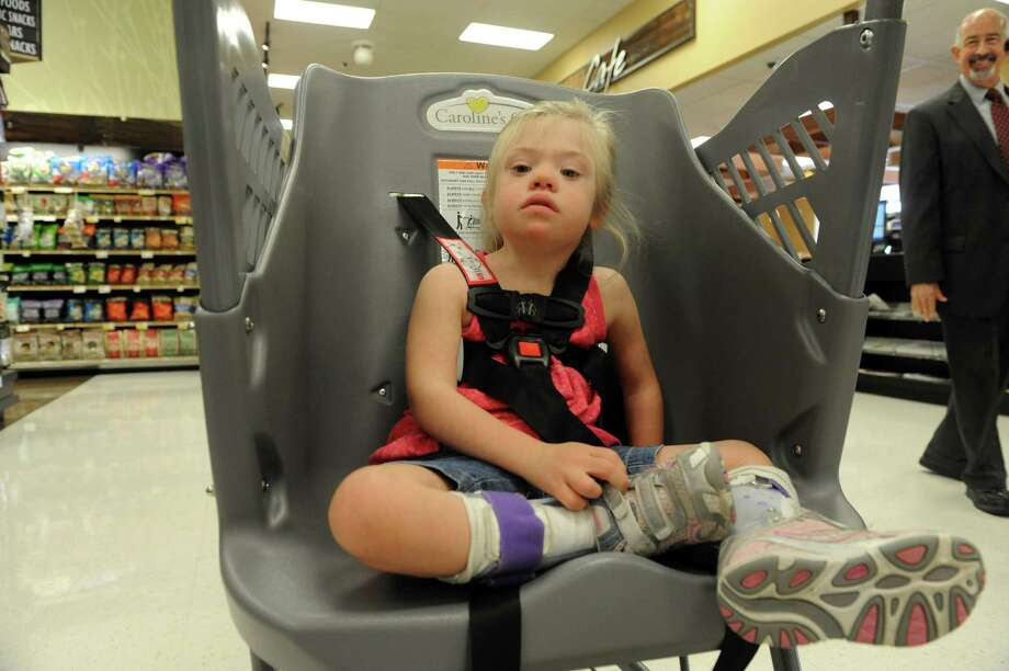 Four-year-old Emily Lautenschlager sits in a Caroline's Cart, a grocery cart designed for children with special needs, as she shops with her mother Lacey at a ShopRite supermarket Thursday morning, Aug. 8, 2013 in Colonie, N.Y. (Michael P. Farrell/Times Union) Photo: Michael P. Farrell / 10023356A
