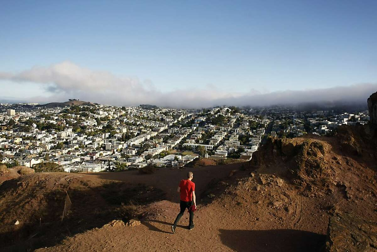 A visitor traverses the top of Corona Heights on August 15, 2013 in San Francisco, Calif.