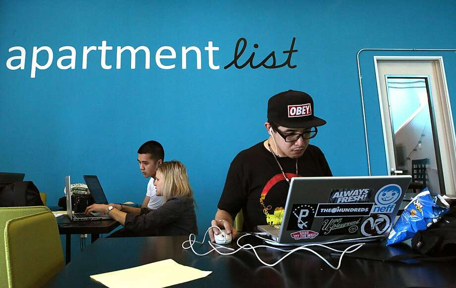 Researcher Patrick Lim, in hat, does work for Apartment List in S.F., which offers a comprehensive set of apartment listings in one interface. Photo: Liz Hafalia, The Chronicle