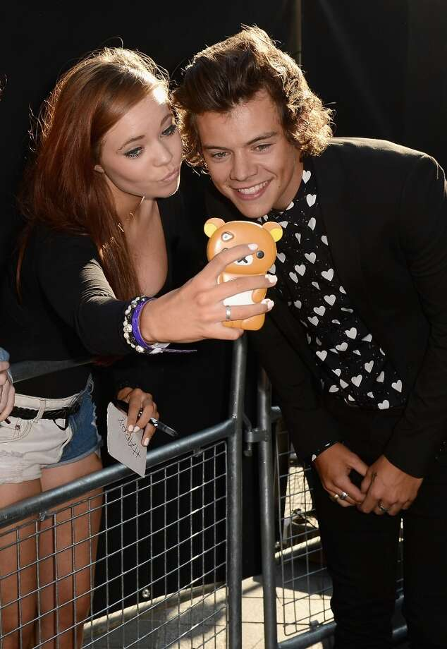 "Singer Harry Styles from One Direction with fans as he attends the ""One Direction This Is Us"" world premiere at the Empire Leicester Square on August 20, 2013 in London, England.  (Photo by Ian Gavan/Getty Images for Sony Pictures) Photo: Ian Gavan"