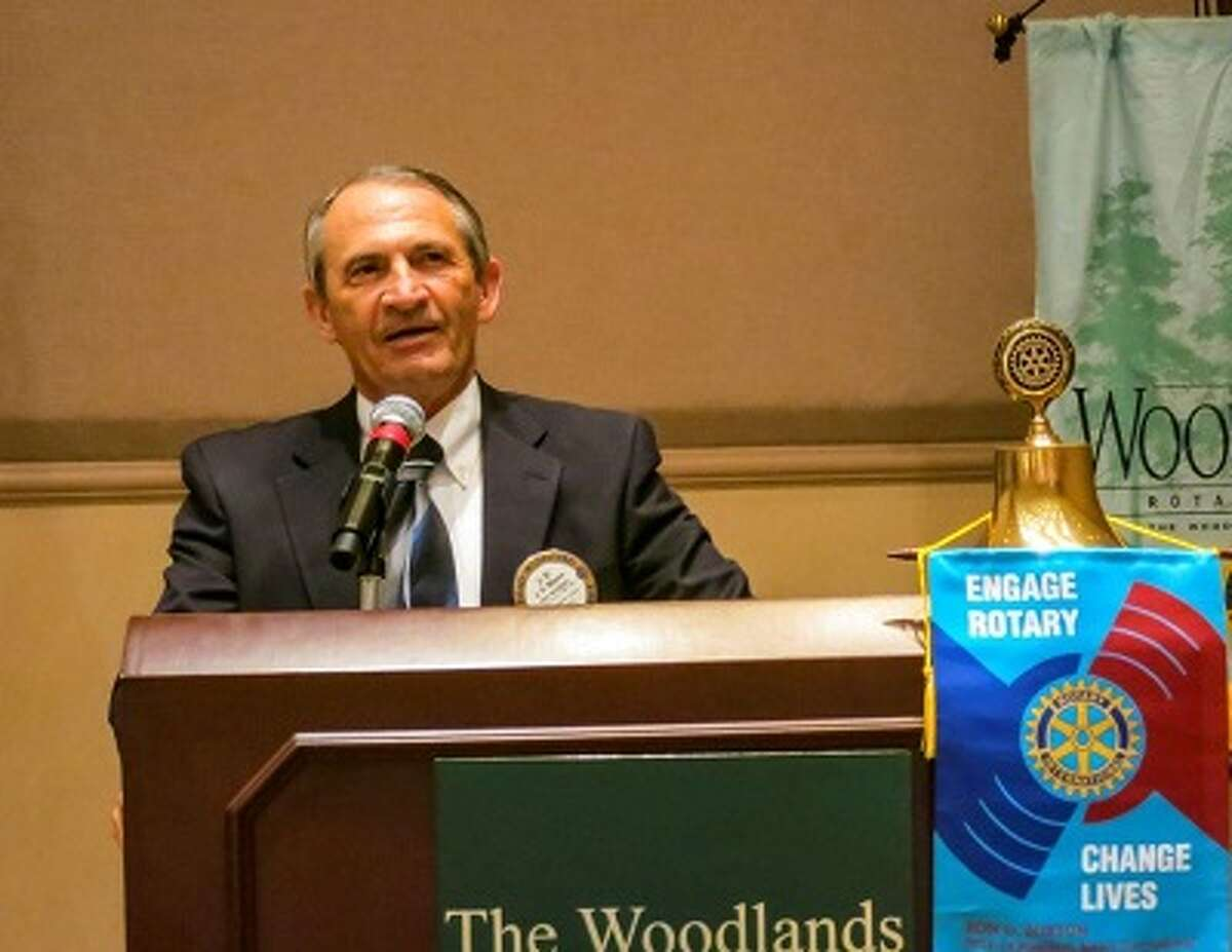 J.R. Moore, Jr., Tax Assessor-Collector of Montgomery County, speaks at The Woodlands Rotary Club meeting July 18.