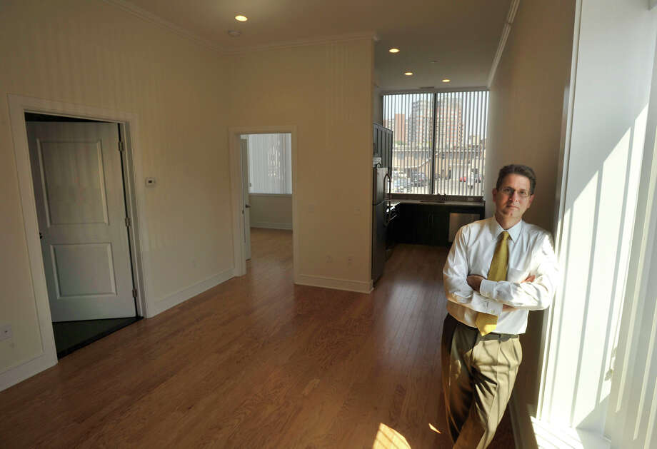 Gregory Lodato, president of MarLo Associates Inc., poses in an apartment building that was converted from office space to apartments along Summer Street in downtown Stamford, Conn., on Tuesday, Aug. 20, 2013. Photo: Jason Rearick / Stamford Advocate