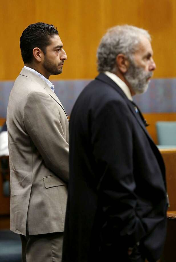 Sonoma County Supervisor Efren Carrillo, left, and his attorney Chris Andrian face Judge Gary Medvigy during a hearing at the Sonoma County Superior Court in Santa Rosa, Calif., on Thursday, July 18, 2013.  Photo: Beth Schlanker, AP