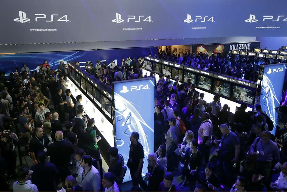 Conference attendees try the new Sony PlayStation 4 during the Electronic Entertainment Expo in Los Angeles in June. Several companies are vying to become the leader in transmitting video game footage. Photo: Jae C. Hong, Associated Press