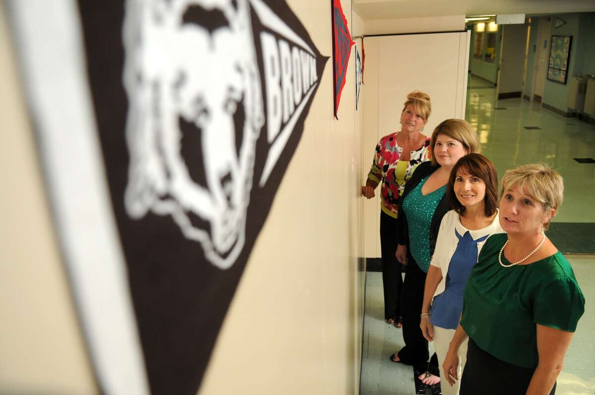 Spring High School Principal Donna Ullrich, right, Intern coordinator Candi Brenner, academy coordinator Maris Peno, and intern coordinator Deb Beeman check out some of the college banners on display in the school hallways to promote Spring High School's new college and career academies.
