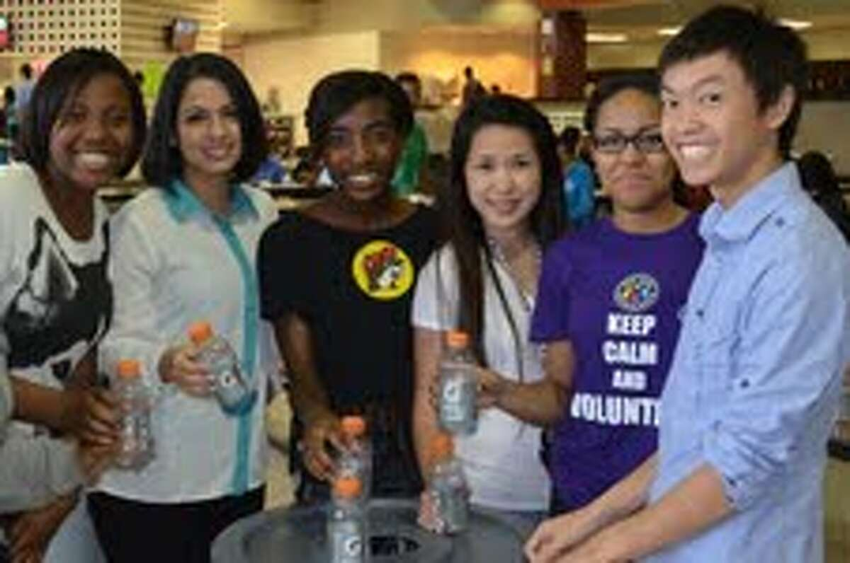 Westfield High School students, from left, Jasmine Hicks, Sylvia Chiapponi, Stephnie Abazie, Anh-Thu Nguyen, Darnelle Desvignes and Mike Dinh help a campus recycling effort.