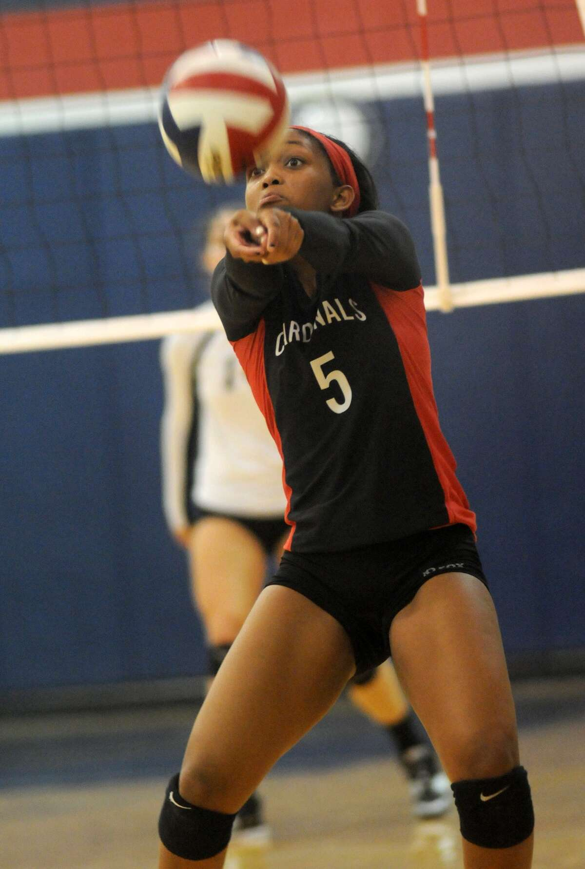 Bellaire setter Briana Shannon works the ball against St Agnes. Freelance photo by Jerry Baker