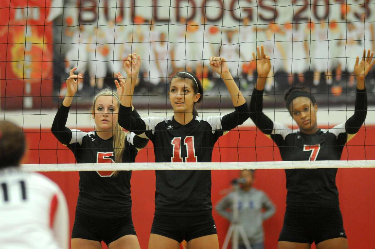Ft Bend Austin's Dylan Brinkman, from left, Madison Wetterstroem, and Nia Johnson team up at the net against Bellaire. Freelance photo by Jerry Baker