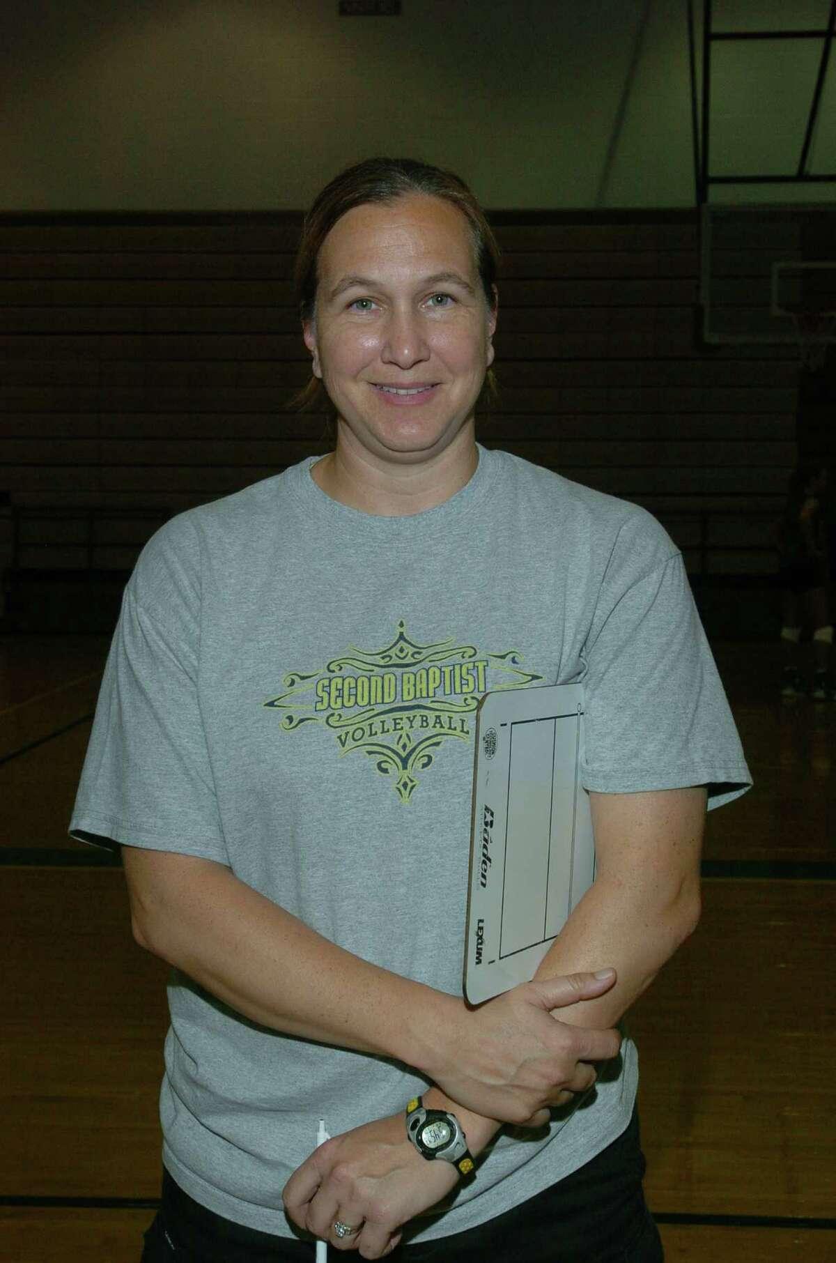 Second Baptist varsity volleyball head coach, Sue Berg. Second Baptist Volleyball team.