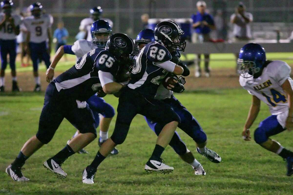 Jaguar running back Sean Kantor and his center Holden Rosenthal work their way up the middle Thursday night.