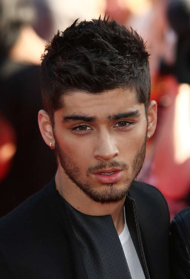 One Direction member Zayn Malikattends the World Premiere of 'One Direction: This Is Us' at Empire Leicester Square on August 20, 2013 in London, England.  (Photo by Tim P. Whitby/Getty Images) Photo: Tim P. Whitby, Getty Images