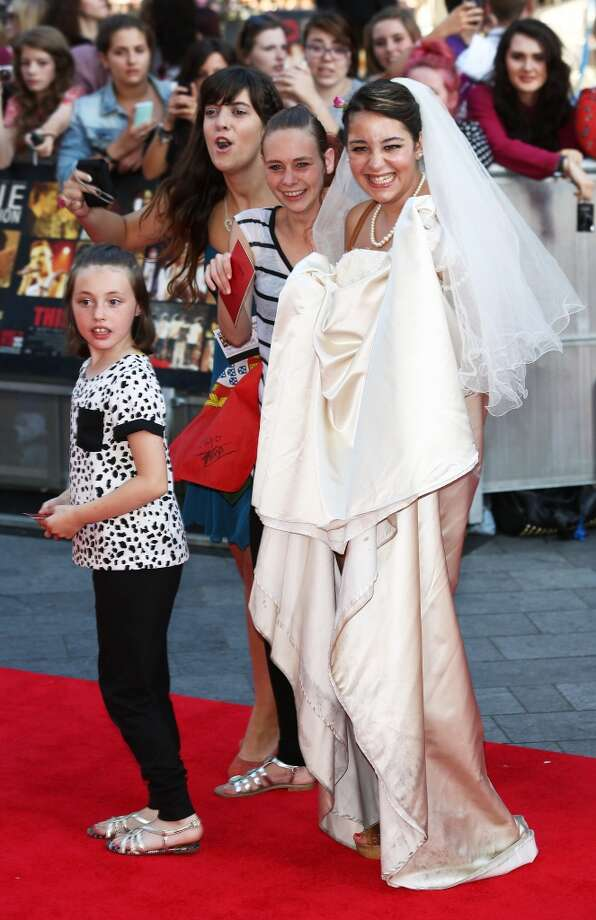 A fan wearing a wedding dress attends the World Premiere of 'One Direction: This Is Us' at Empire Leicester Square on August 20, 2013 in London, England.  (Photo by Tim P. Whitby/Getty Images) Photo: Tim P. Whitby, Getty Images