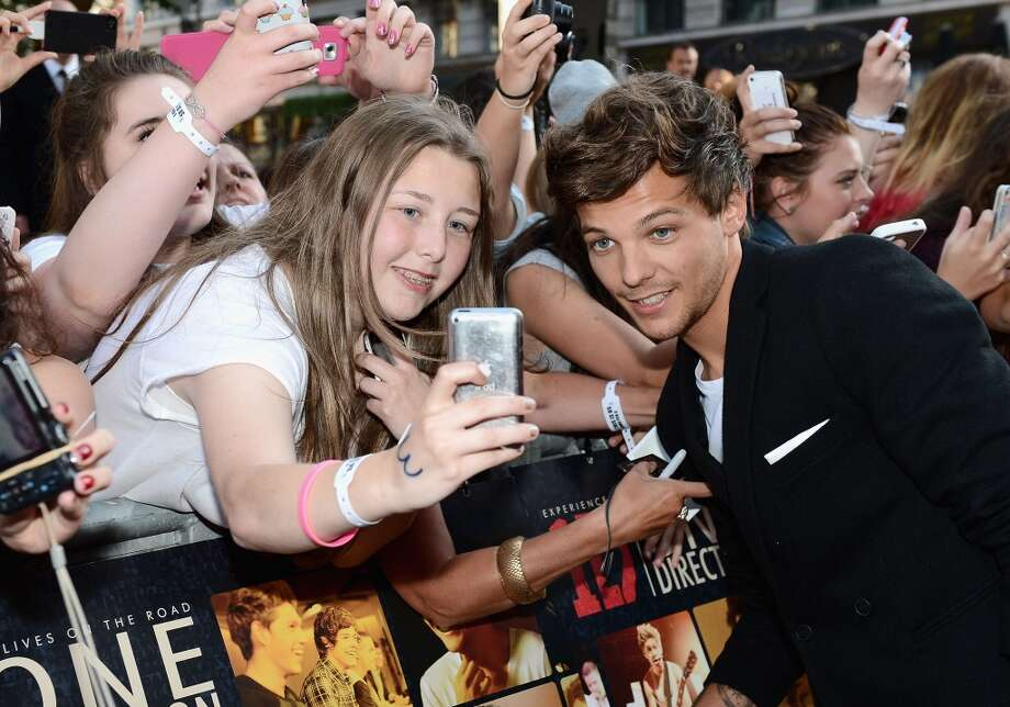 "Singer Louis Tomlinson from One Direction attends the ""One Direction This Is Us"" world premiere at the Empire Leicester Square on August 20, 2013 in London, England.  (Photo by Ian Gavan/Getty Images for Sony Pictures) Photo: Ian Gavan"