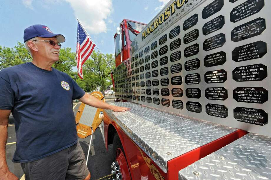 Kevin Shephard of Greenwich looks at the names of fallen firefighters on the MacBoston18 Truck parked at the Desmond for the MacBoston 18 Truck event on Tuesday, Aug. 20, 2013 in Colonie, N.Y. The MacBoston 18 Truck is an organization dedicated to the memory of New York State fallen firefighters who have died in the line of duty. (Lori Van Buren / Times Union) Photo: Lori Van Buren / 00023582A