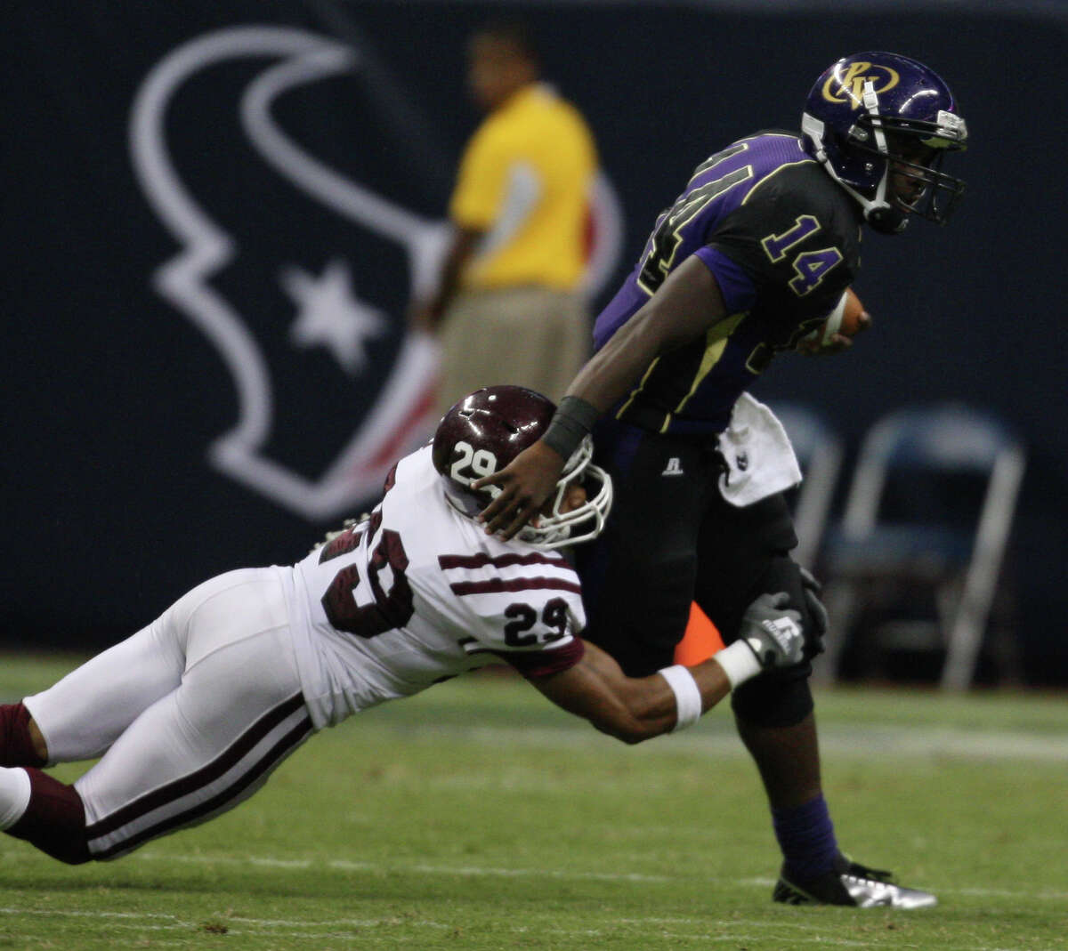Prairie View quarterback De'Auntre Smiley (14) is sacked by Texas Southern's Le'Tevin Wilcox during the first half of the Labor Day Classic, Saturday, September 1, 2012 at Reliant Stadium in Houston.
