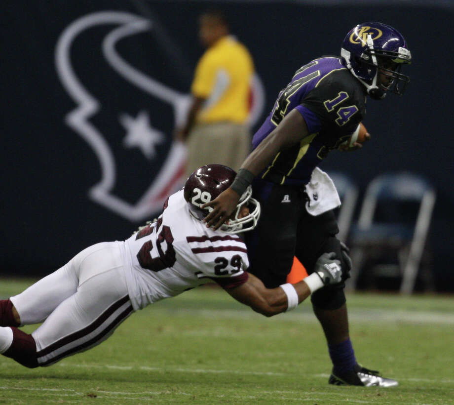 Prairie View quarterback De'Auntre Smiley (14) is sacked by Texas Southern's Le'Tevin Wilcox during the first half of the Labor Day Classic, Saturday, September 1, 2012 at Reliant Stadium in Houston. Photo: Eric Christian Smith, For The Chronicle