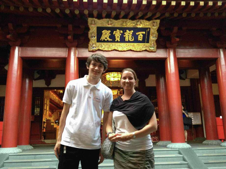 Teacher Mare Stewart and student Cosmo Albrecht of the International School of the Americas, near Castle Hills, were part of a month-long educational trip to Southeast Asia. Here they're seen at the Buddha Tooth Relic Temple and Museum in Singapore's Chinatown.