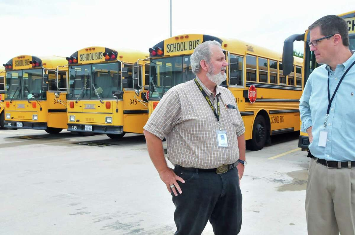 Jim Porter, Katy Independent School District assistant director for transportation services, meets with Steve Stanford, district spokesman, at the district's South Transportation Center.